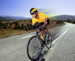 7776293 - a cyclist riding a bike on an open road in macedonia