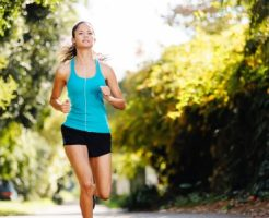 14342145 - running healthy fitness woman training for marathon outdoors in alleyway  vitality lifestyle exercise athlete